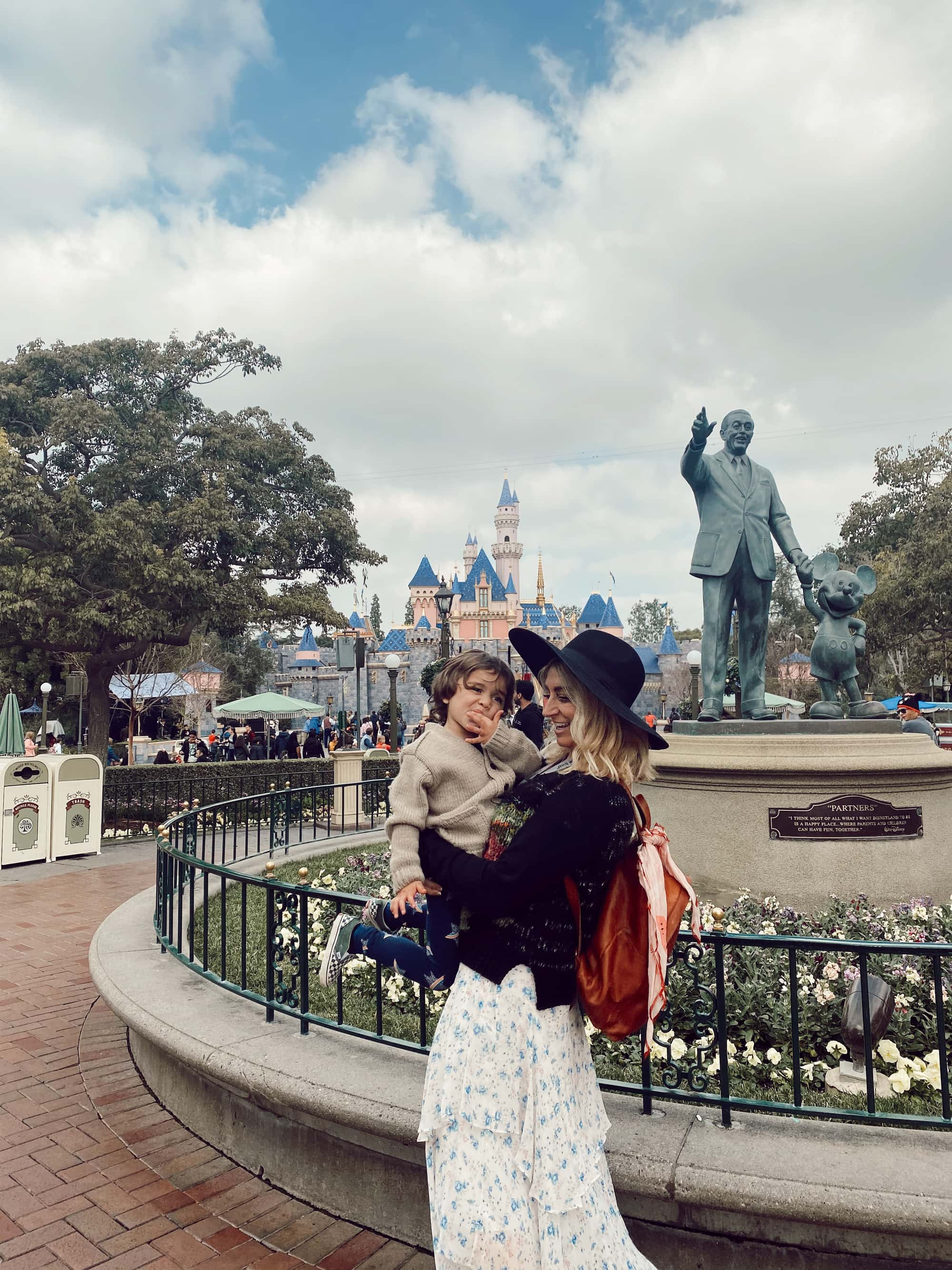 mother holding son at disneyland