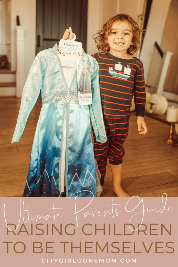 child holding costume