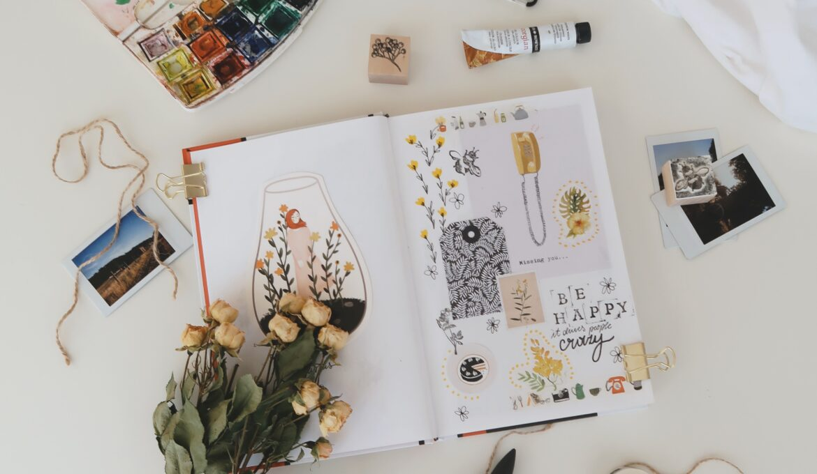 open journal with art and photos