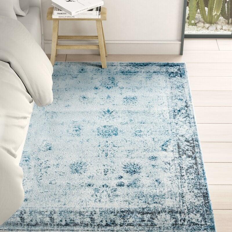 blue rug on floor