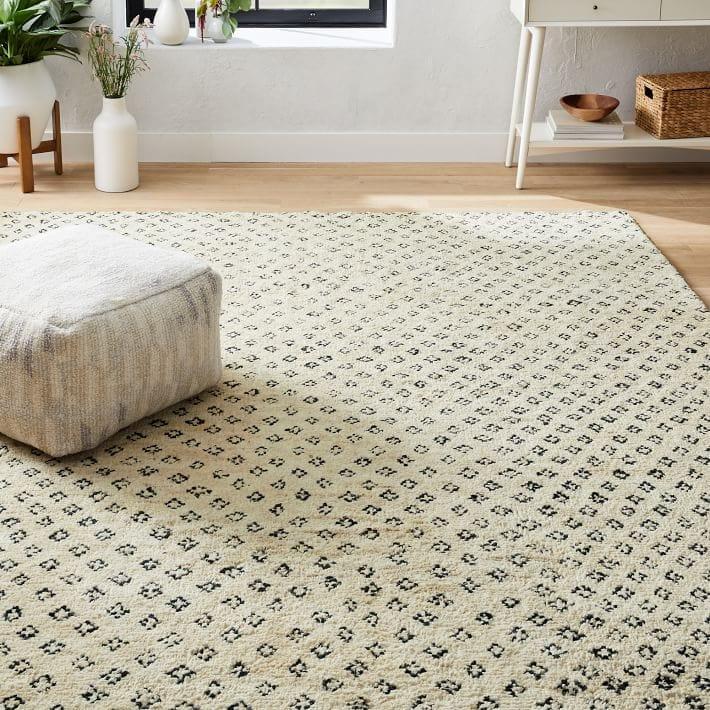 cream rug on floor
