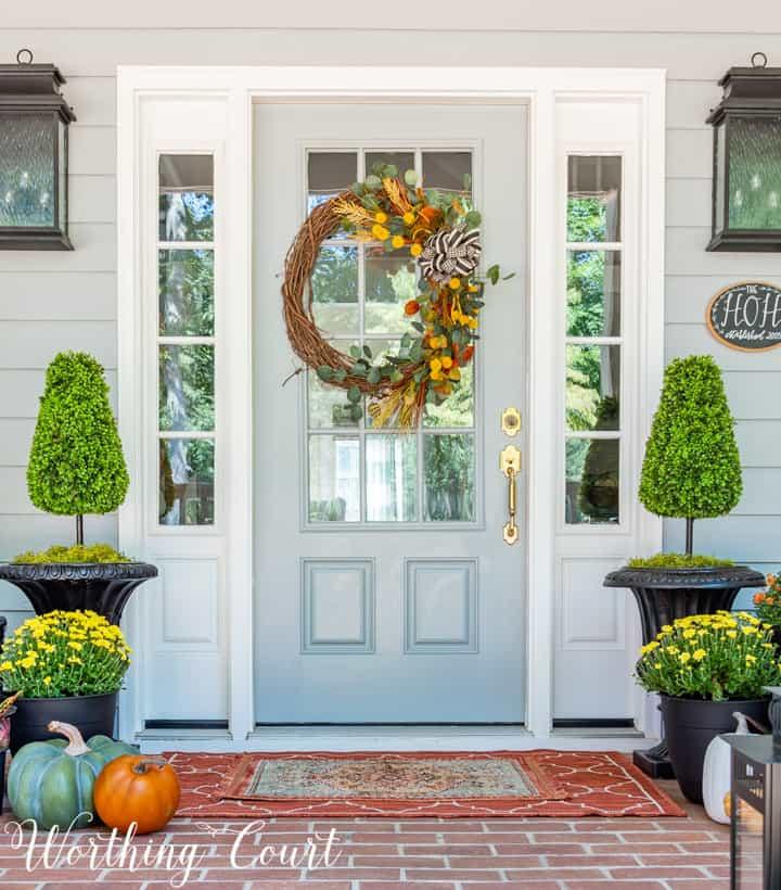 blue front door with wreath