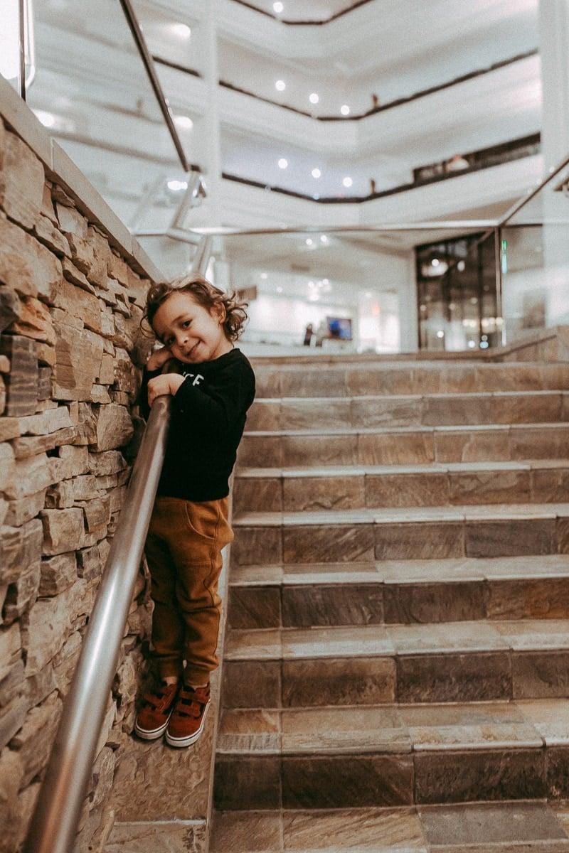 toddler posing on stairs
