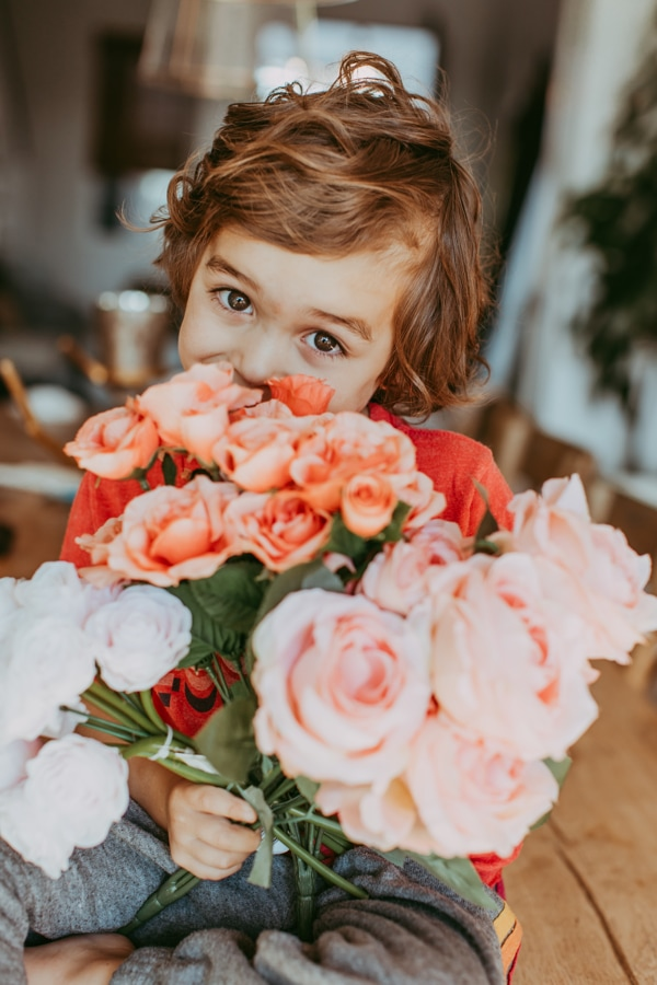 toddler with flowers