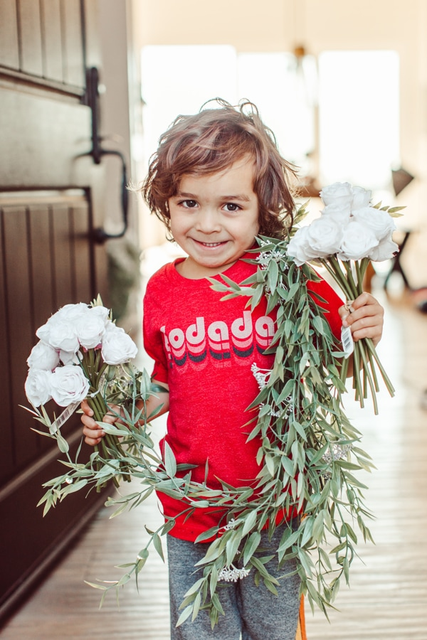 toddler holding flowers