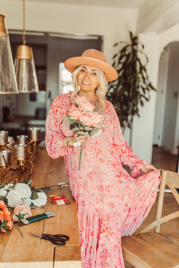 woman in dress holding flowers