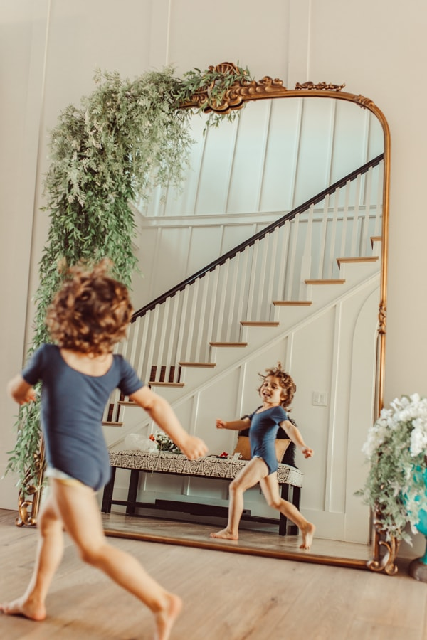 toddler running by mirror