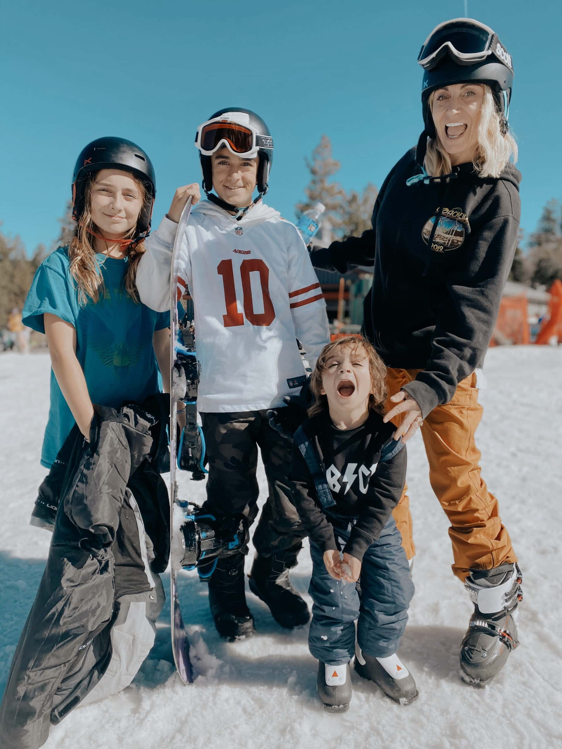 mom skiing with kids