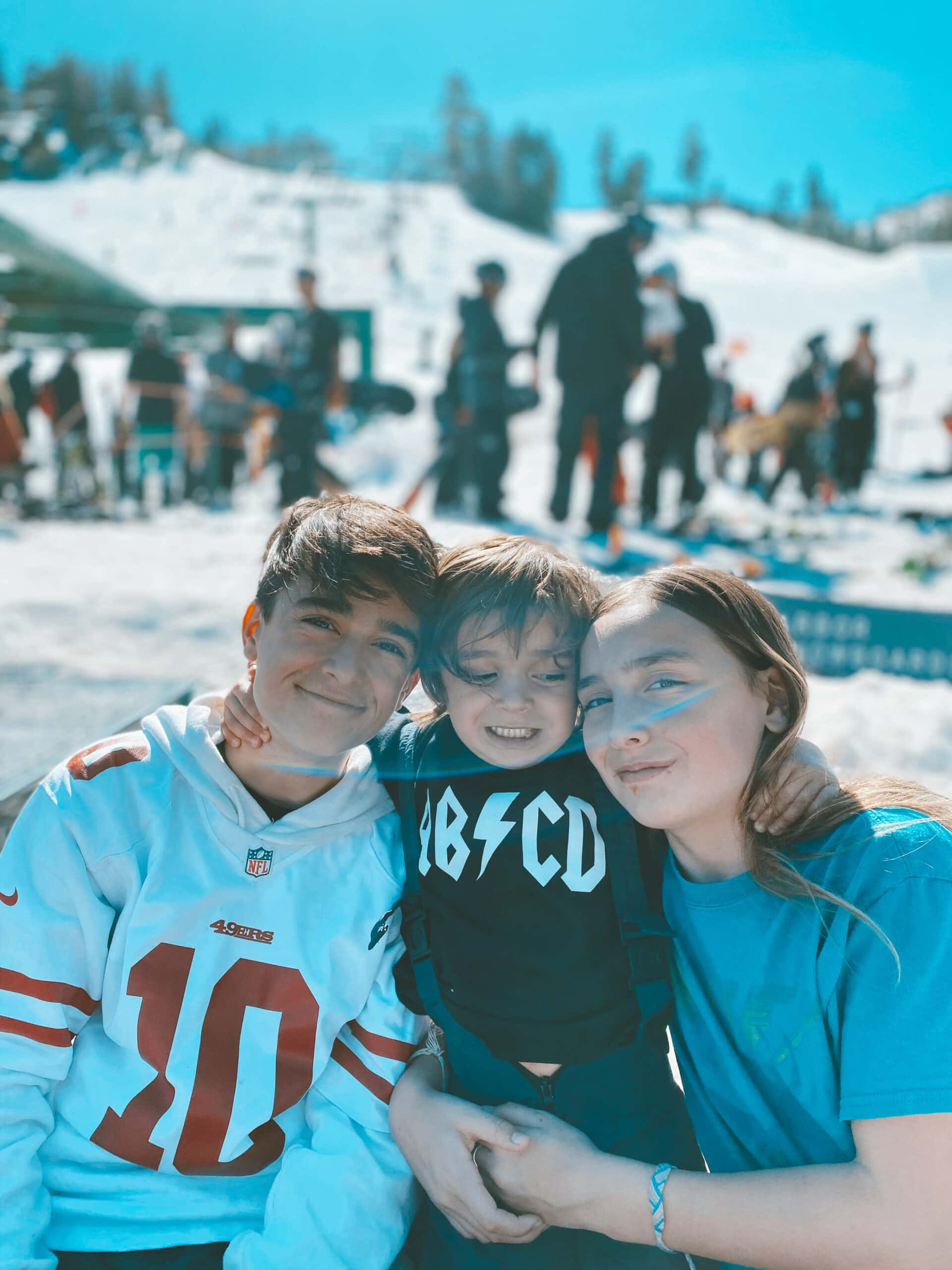 kids hugging at ski resort