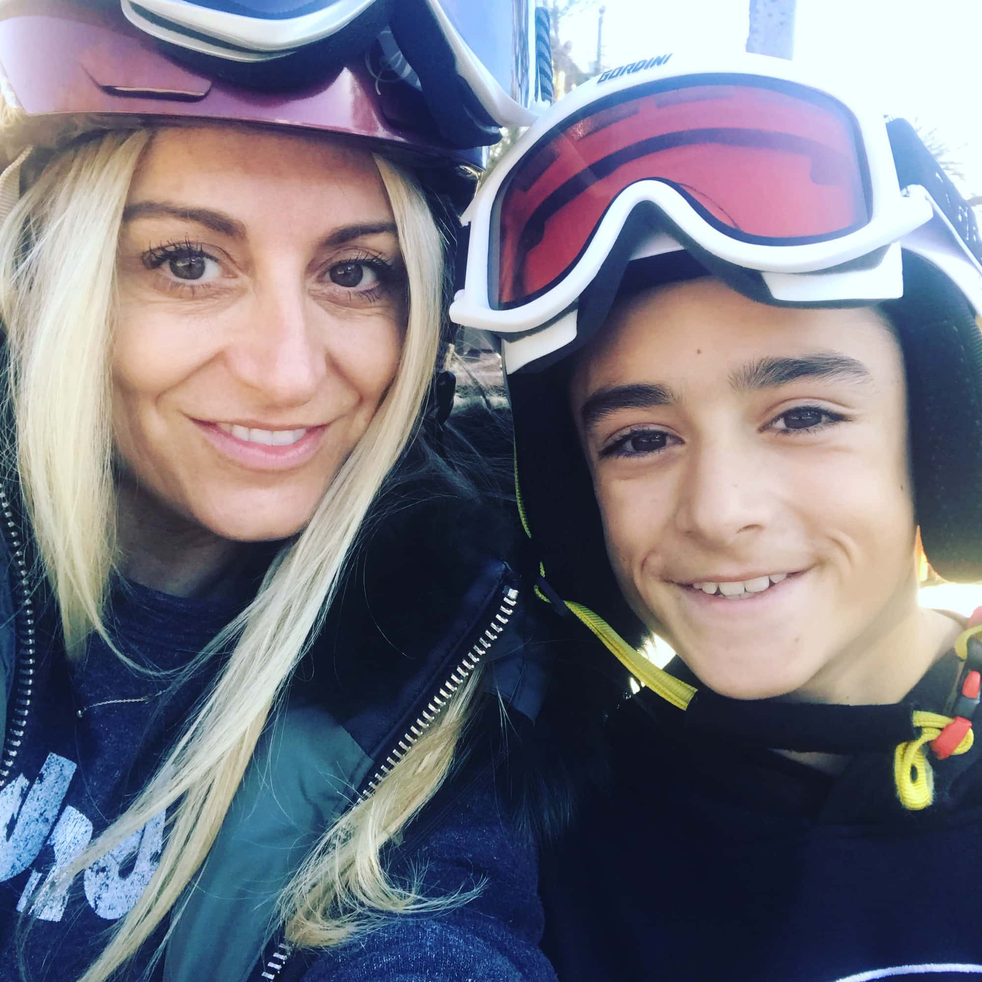 mom and son skiing