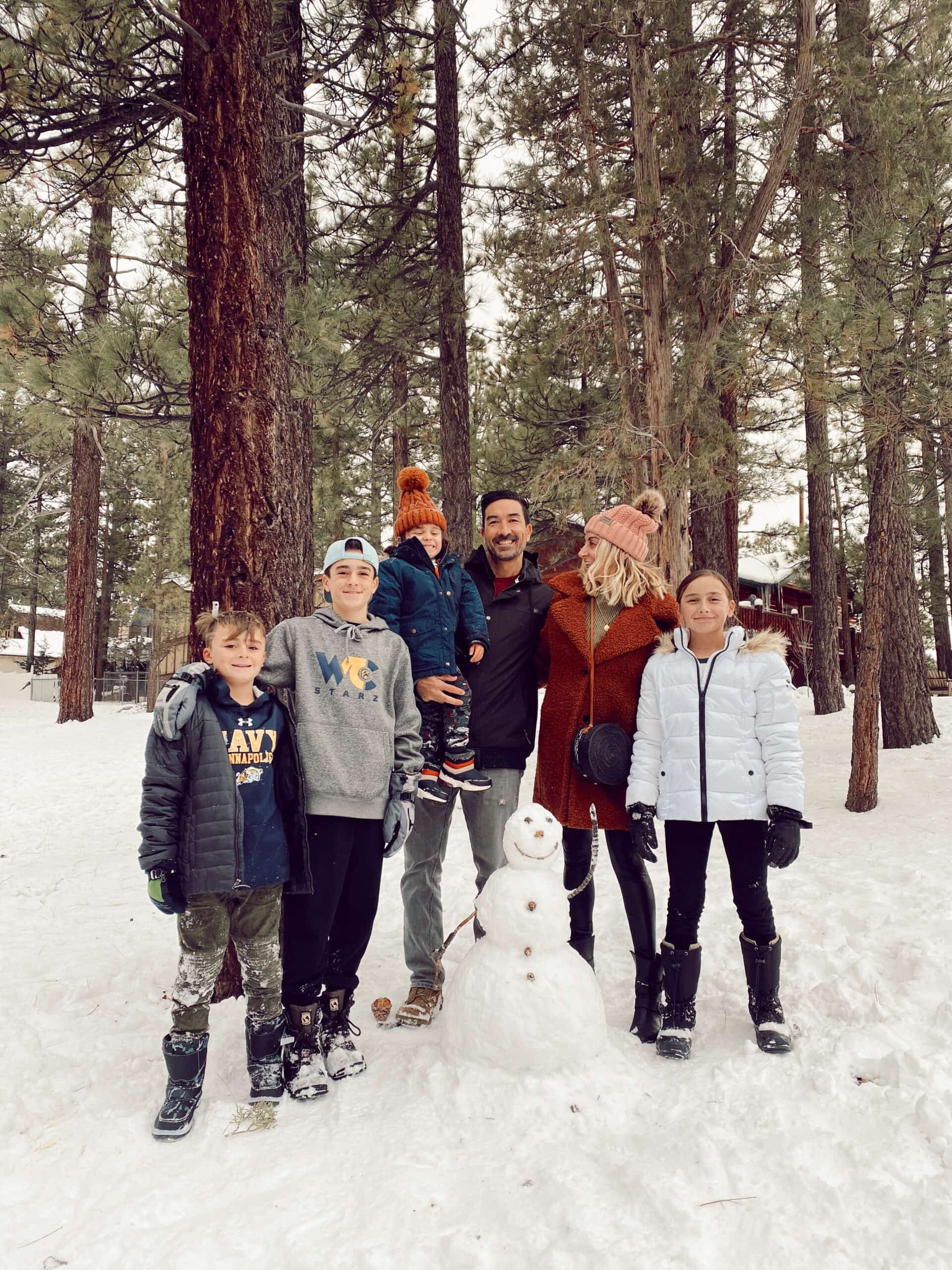 family building snowman in the forest