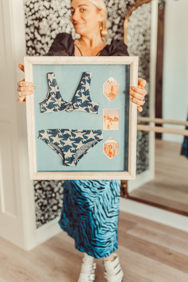 woman holding bikini keepsake