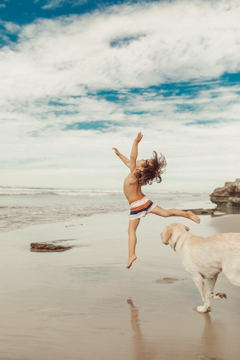dancing kid on beach