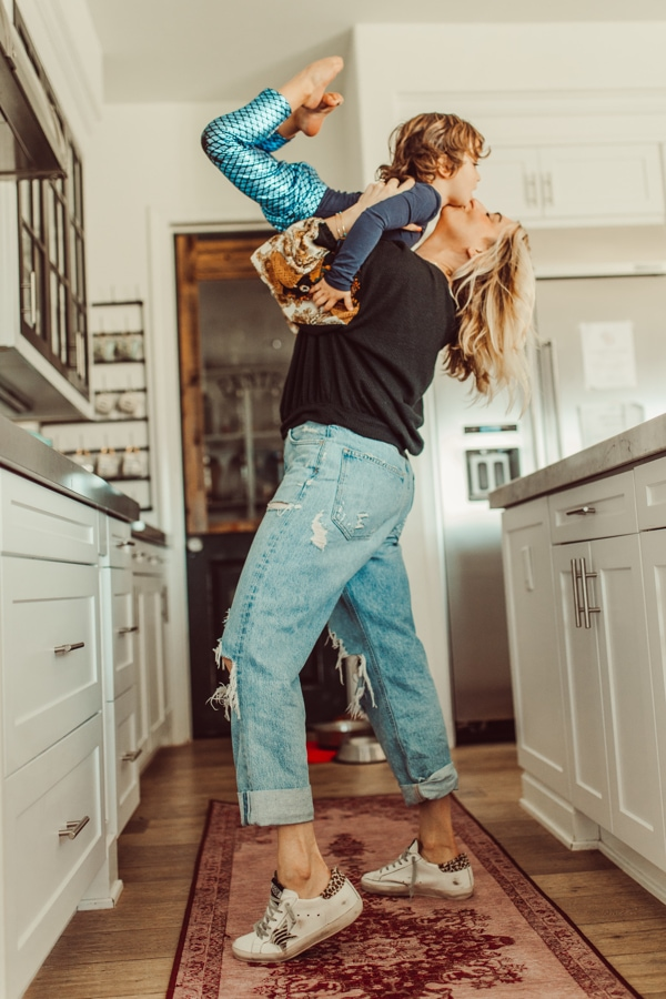 mom and baby dancing in kitchen