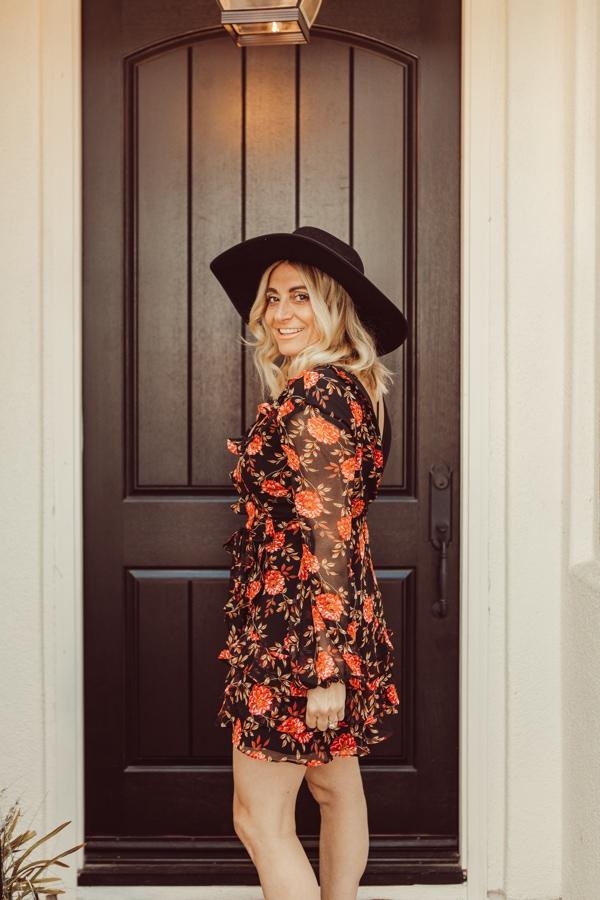 stylish woman by door