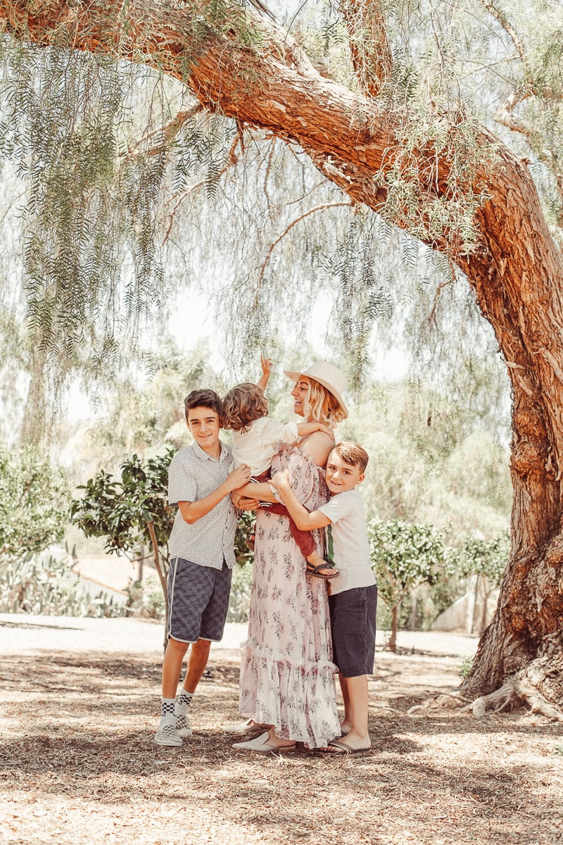mom and sons under tree