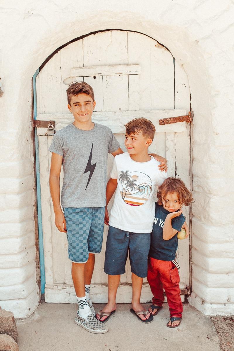 three boys by door