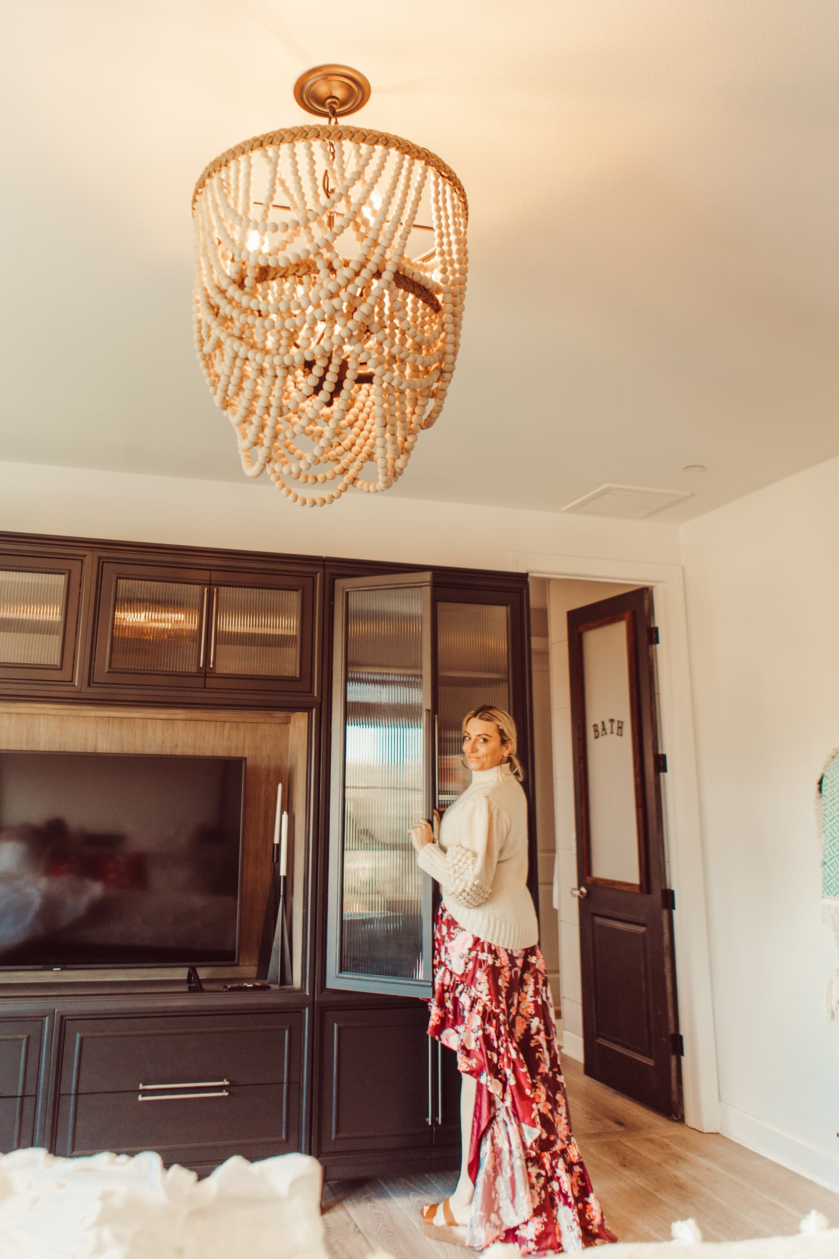 woman looking through cabinets