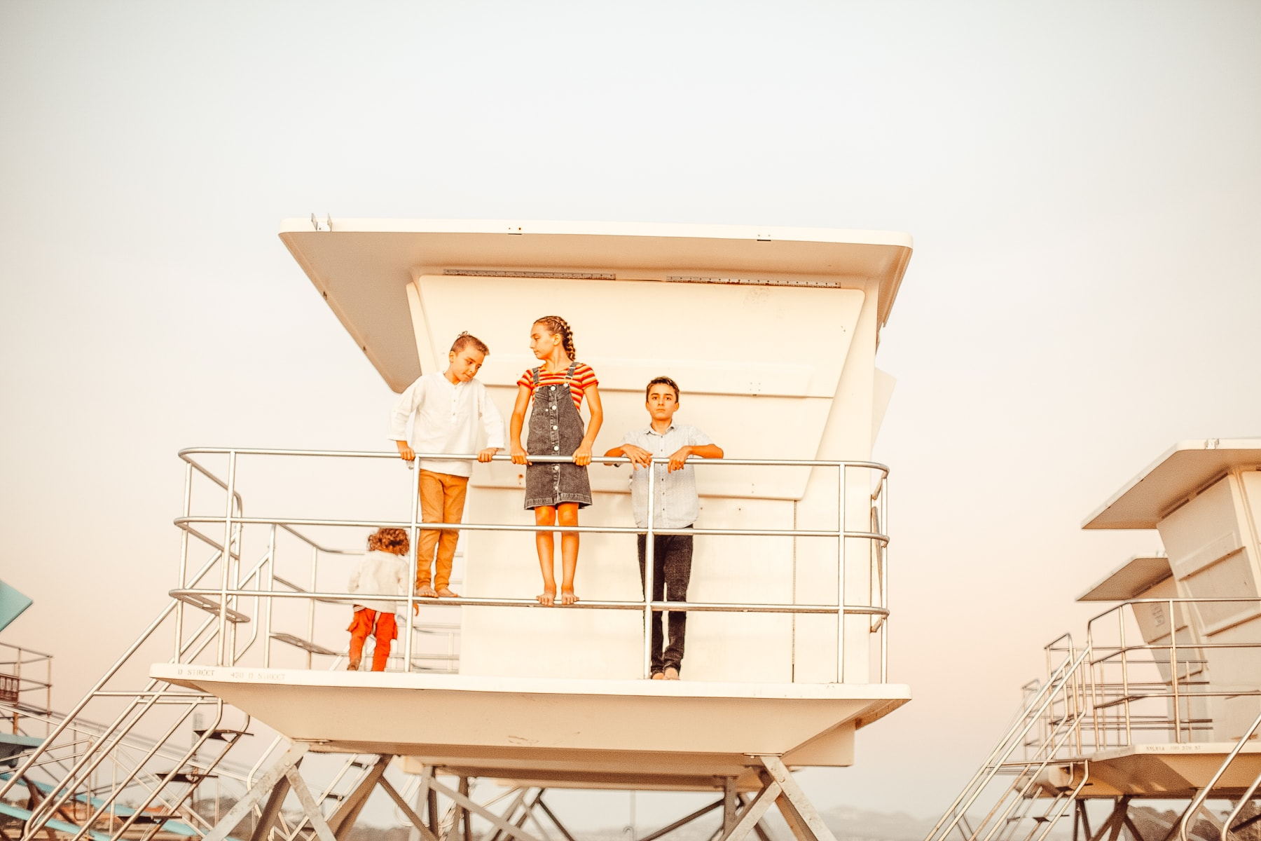 kids on lifeguard tower