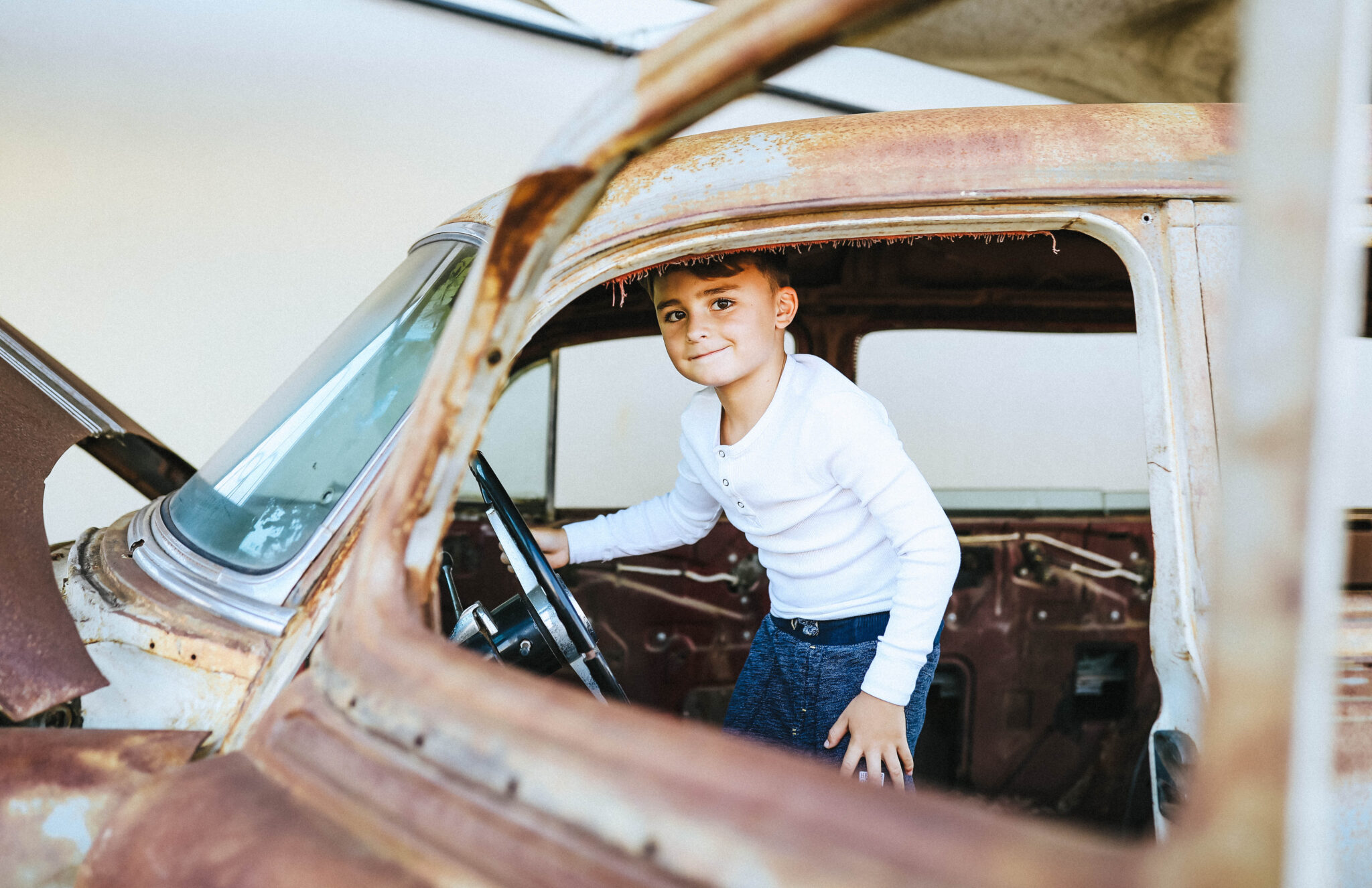 boy in old car