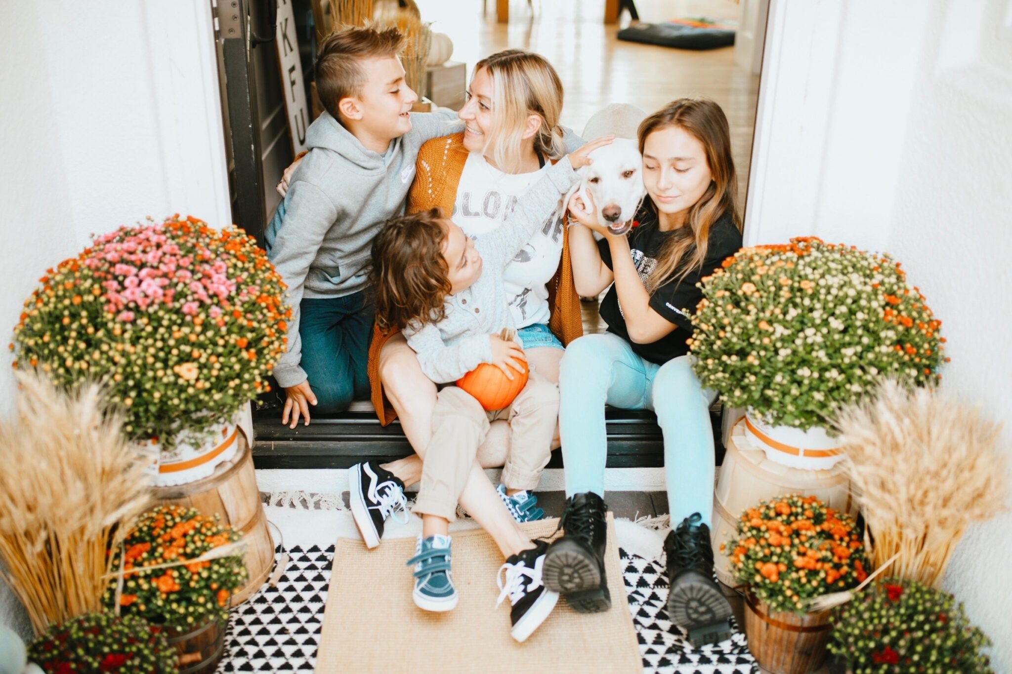 mom with her kids and dog