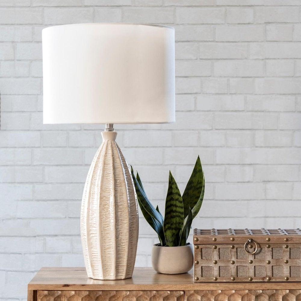 white lamp with plant