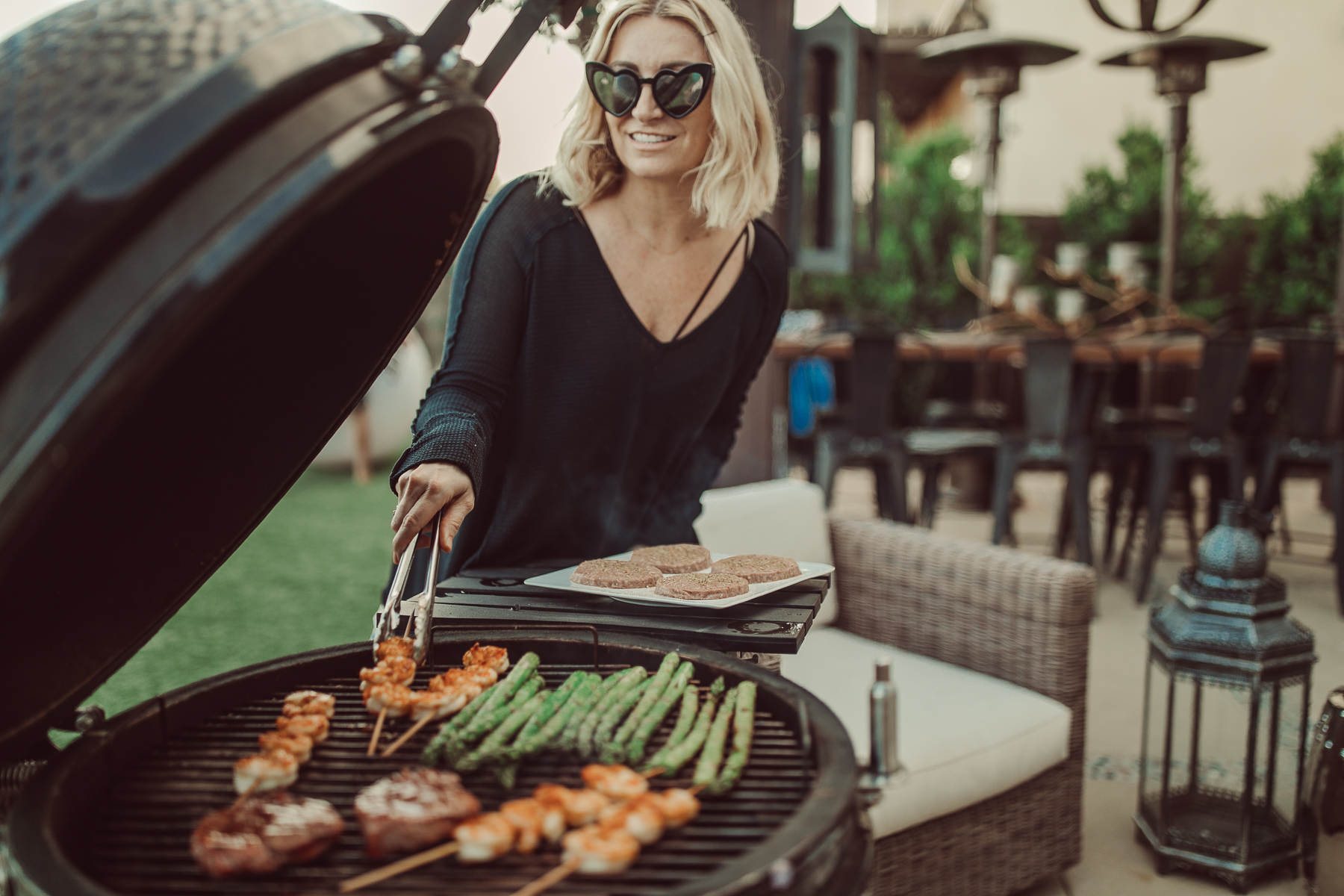 woman cooking on the grill
