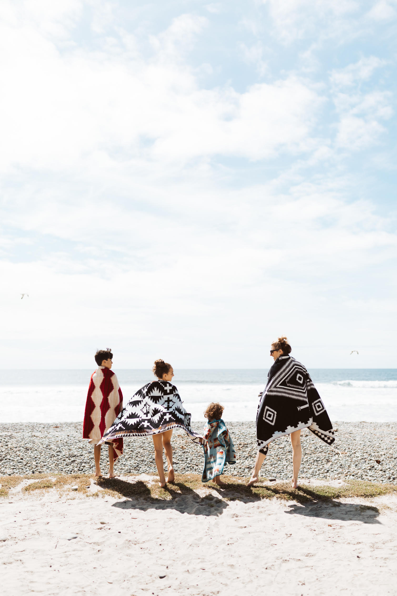 mom and kids at the beach