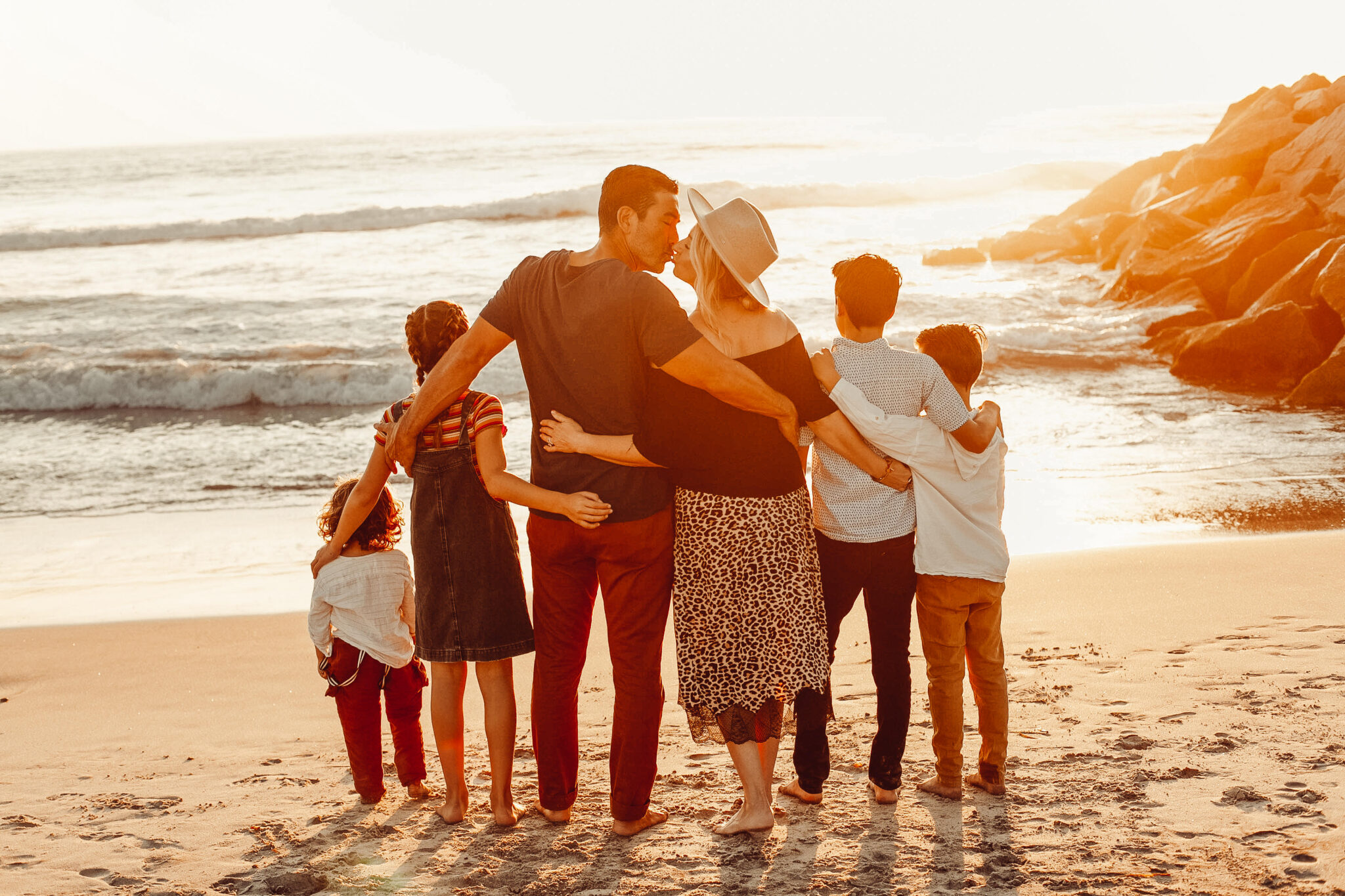 loving family on the beach at sunset