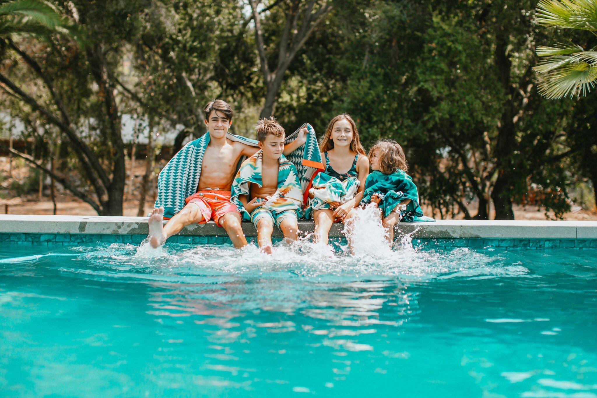 kids sitting in pool