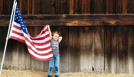 boy holding the American flag
