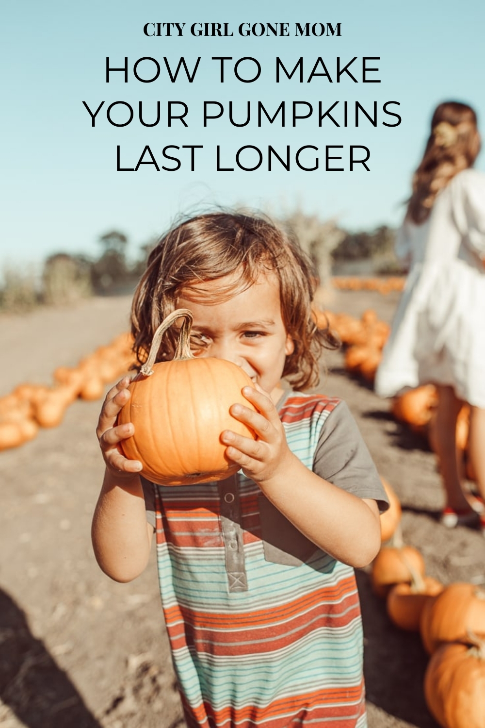 toddler with pumpkin