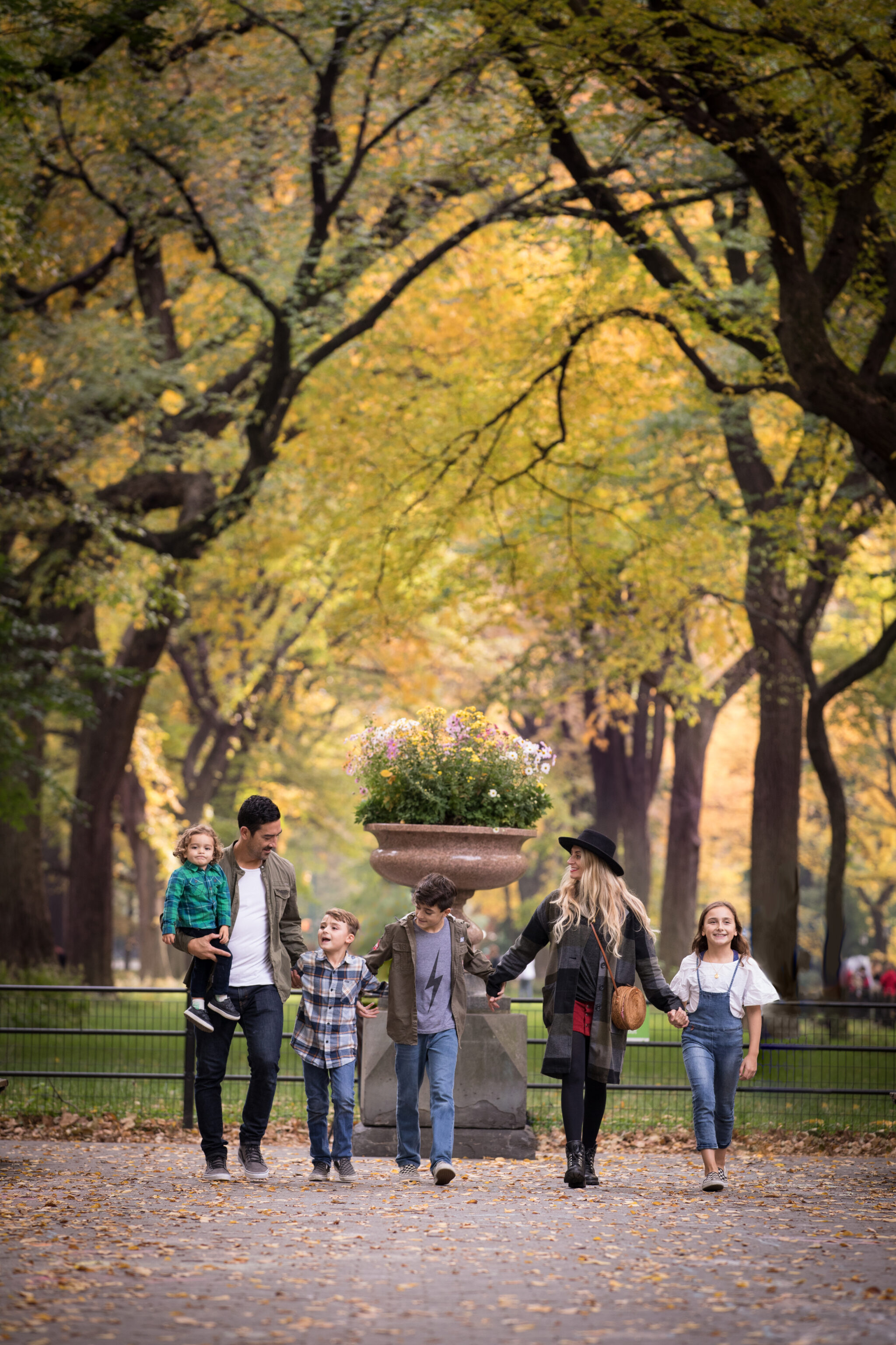 family walking in central park