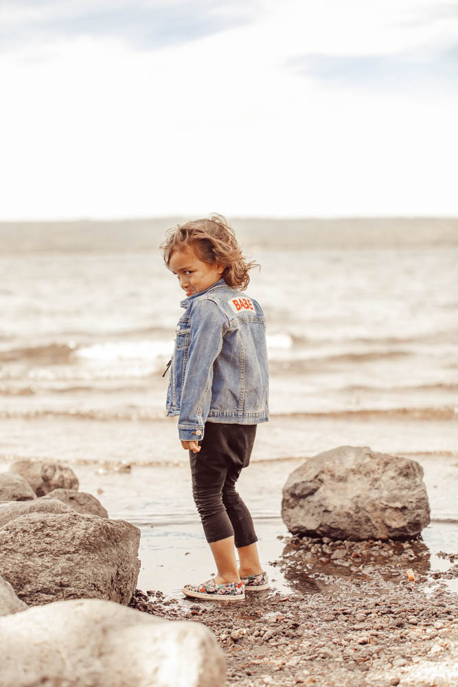 boy standing on the shore