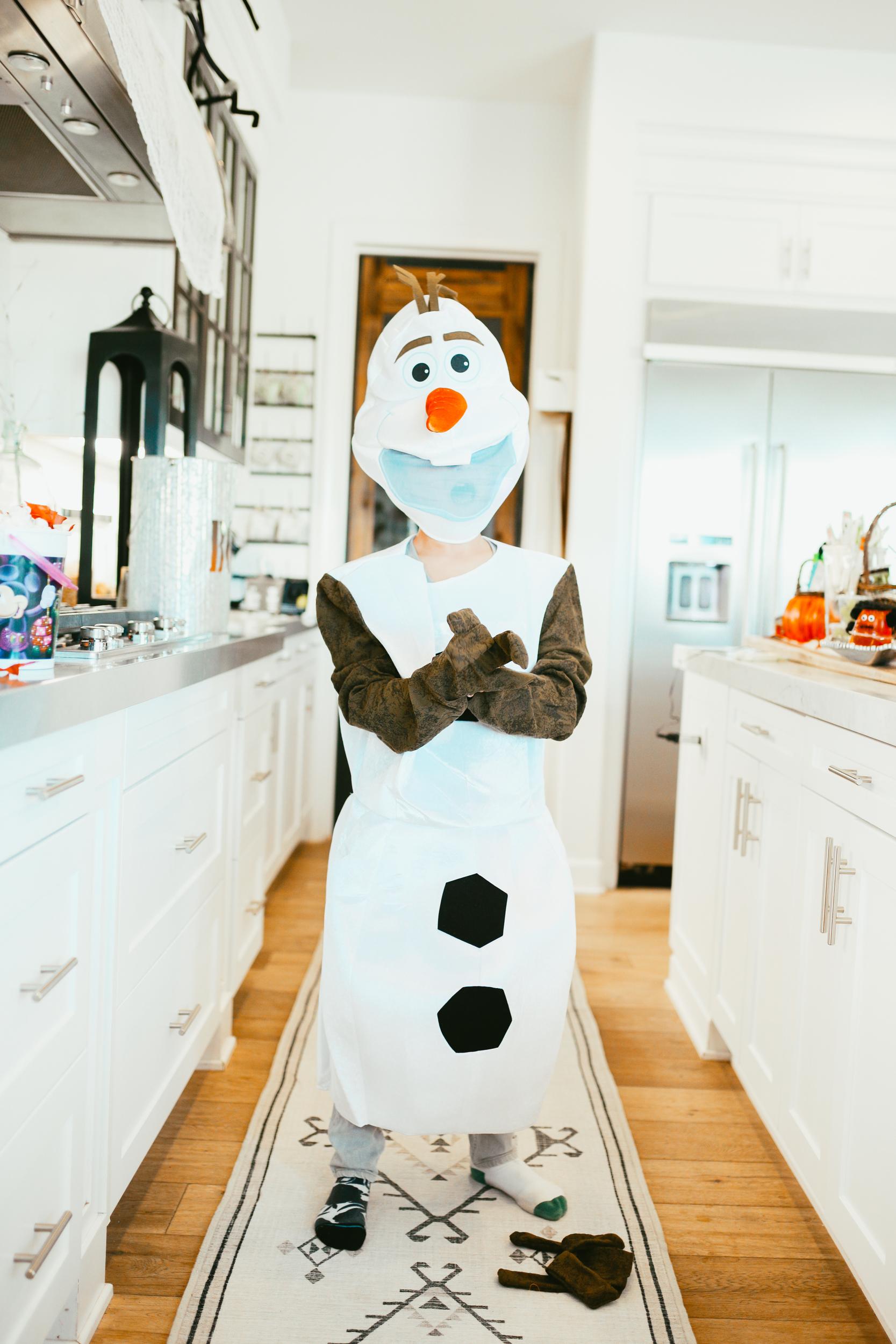 kid dressed as snowman