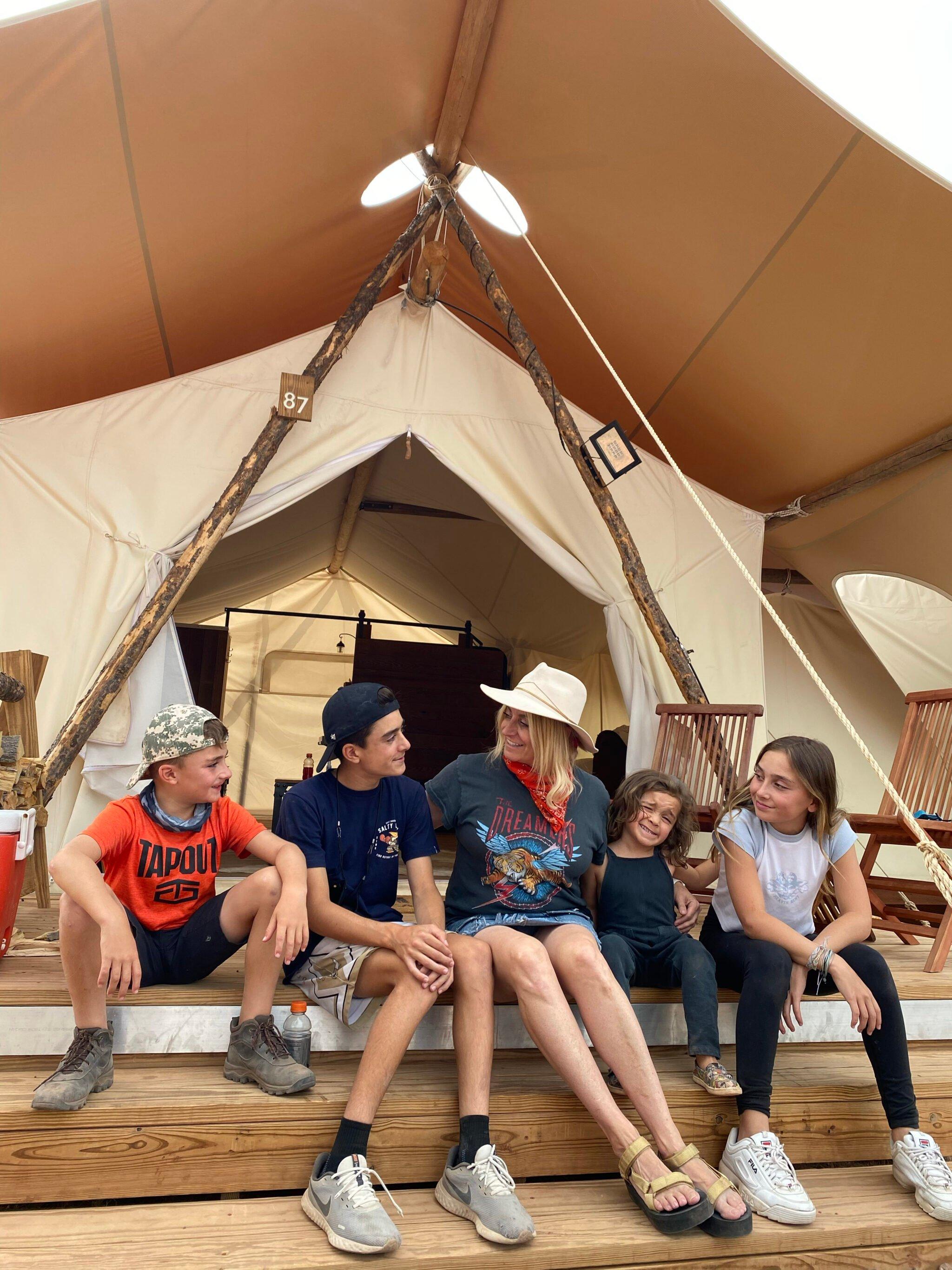 family at camping tent