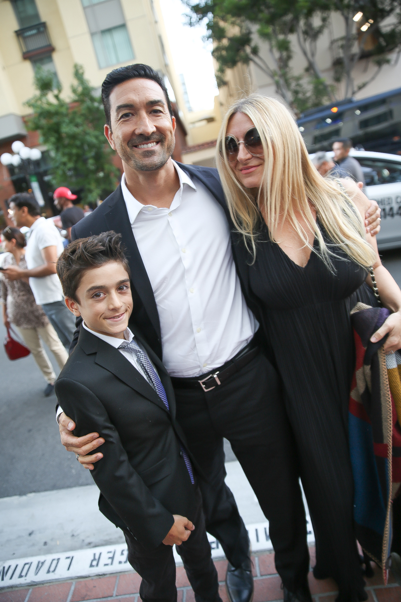 family at movie premiere