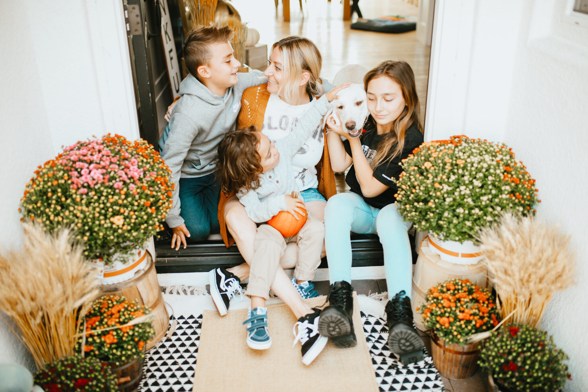 mom with kids on porch