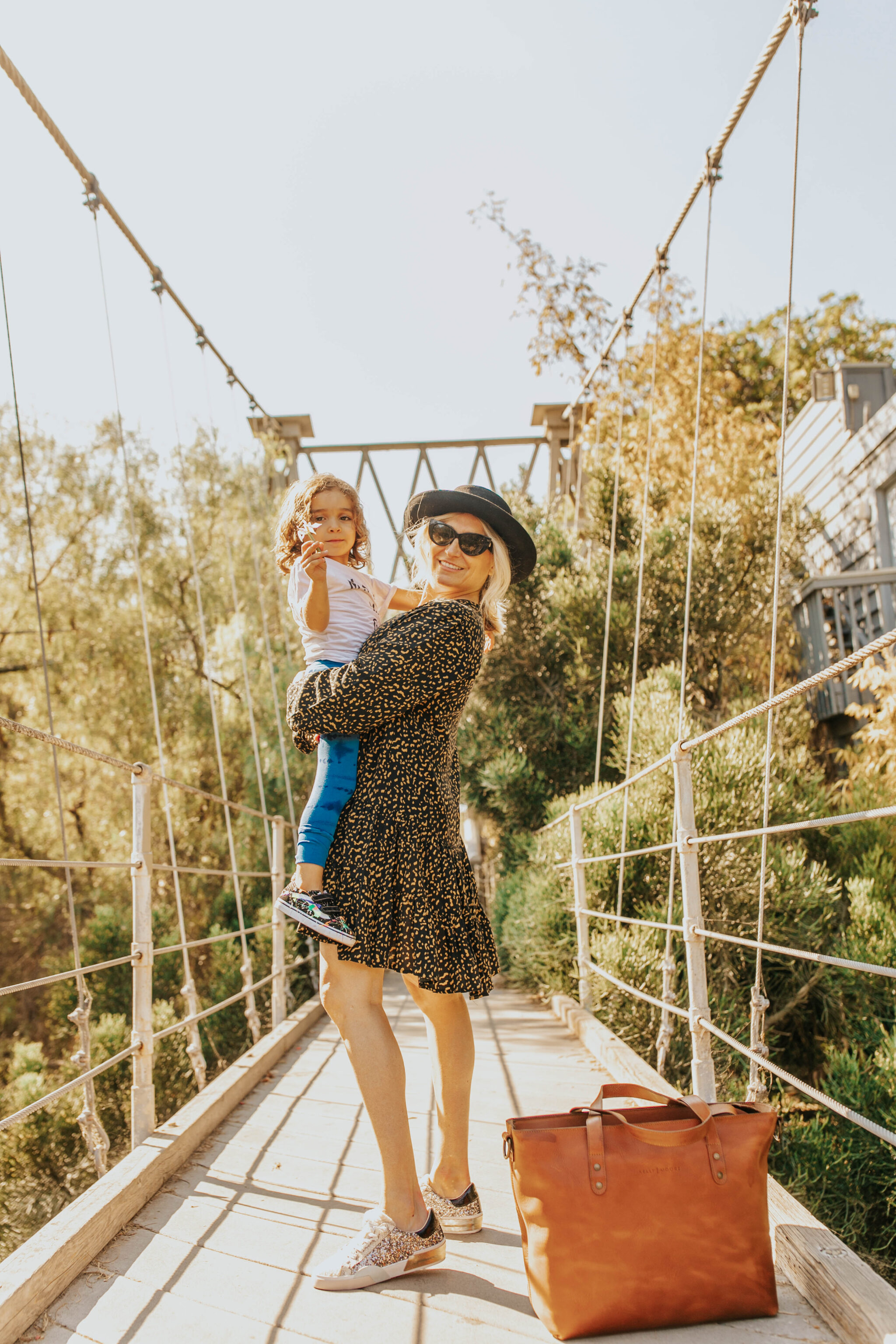 mom and toddler on bridge
