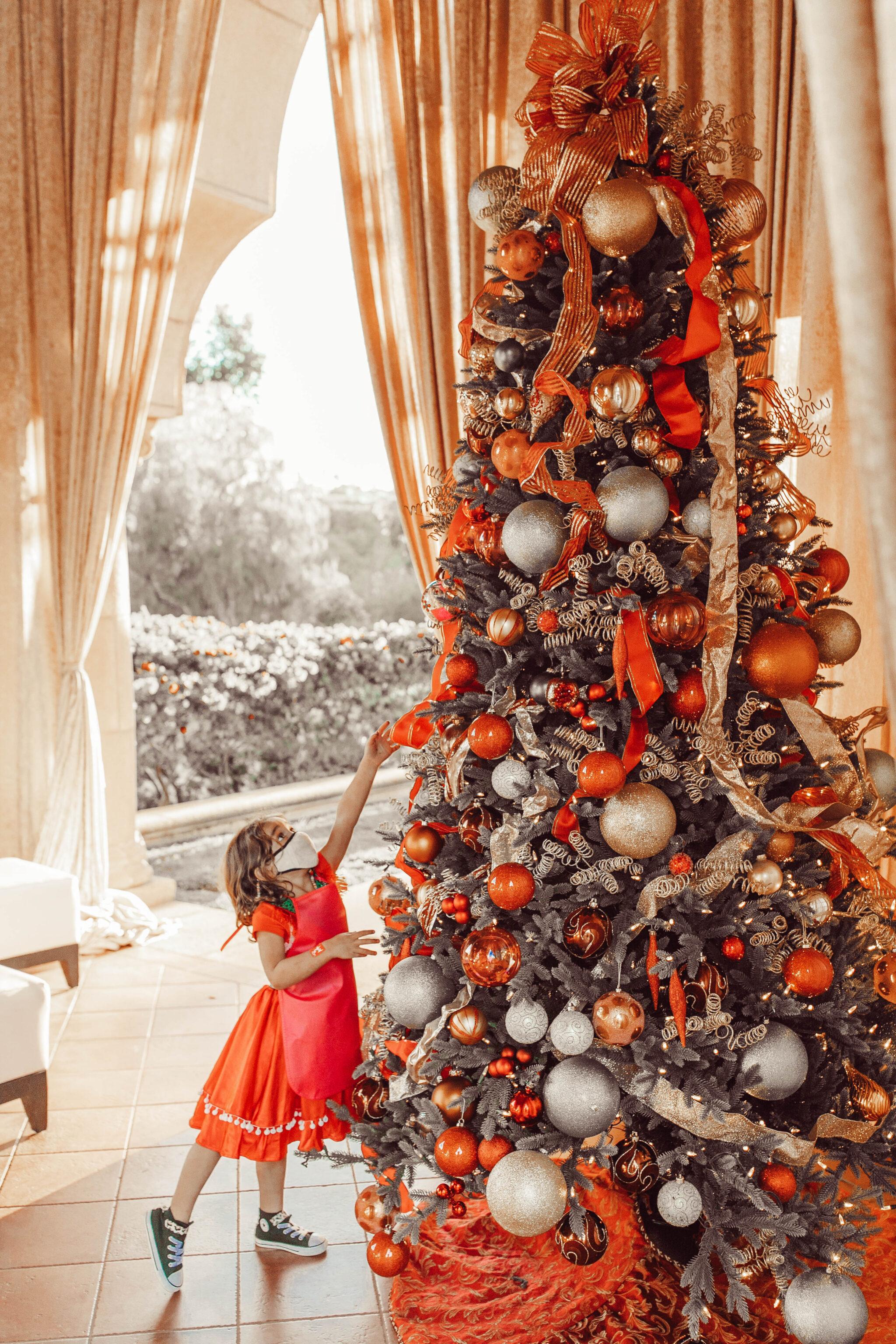 child touching christmas tree