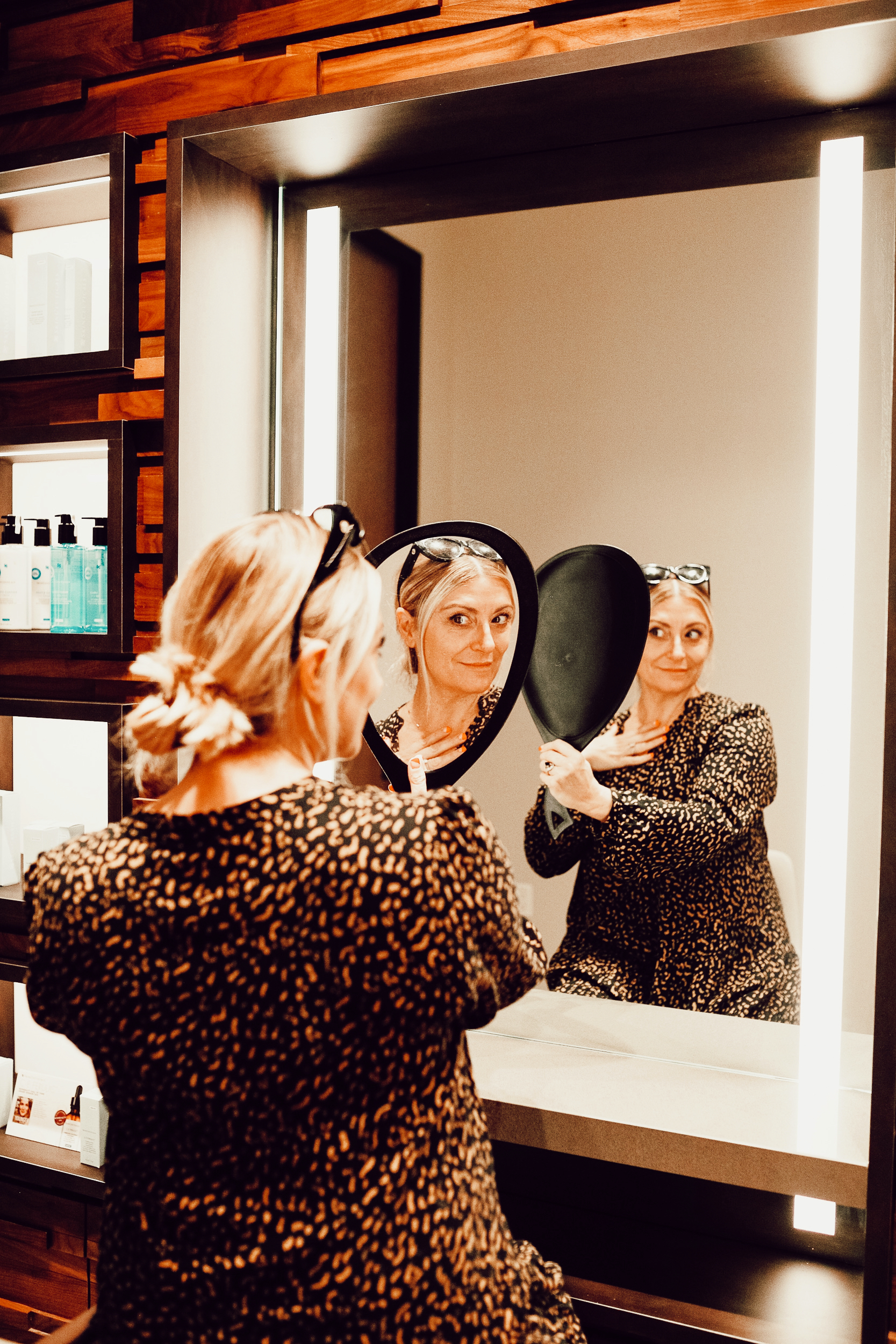 woman admiring herself in a mirror