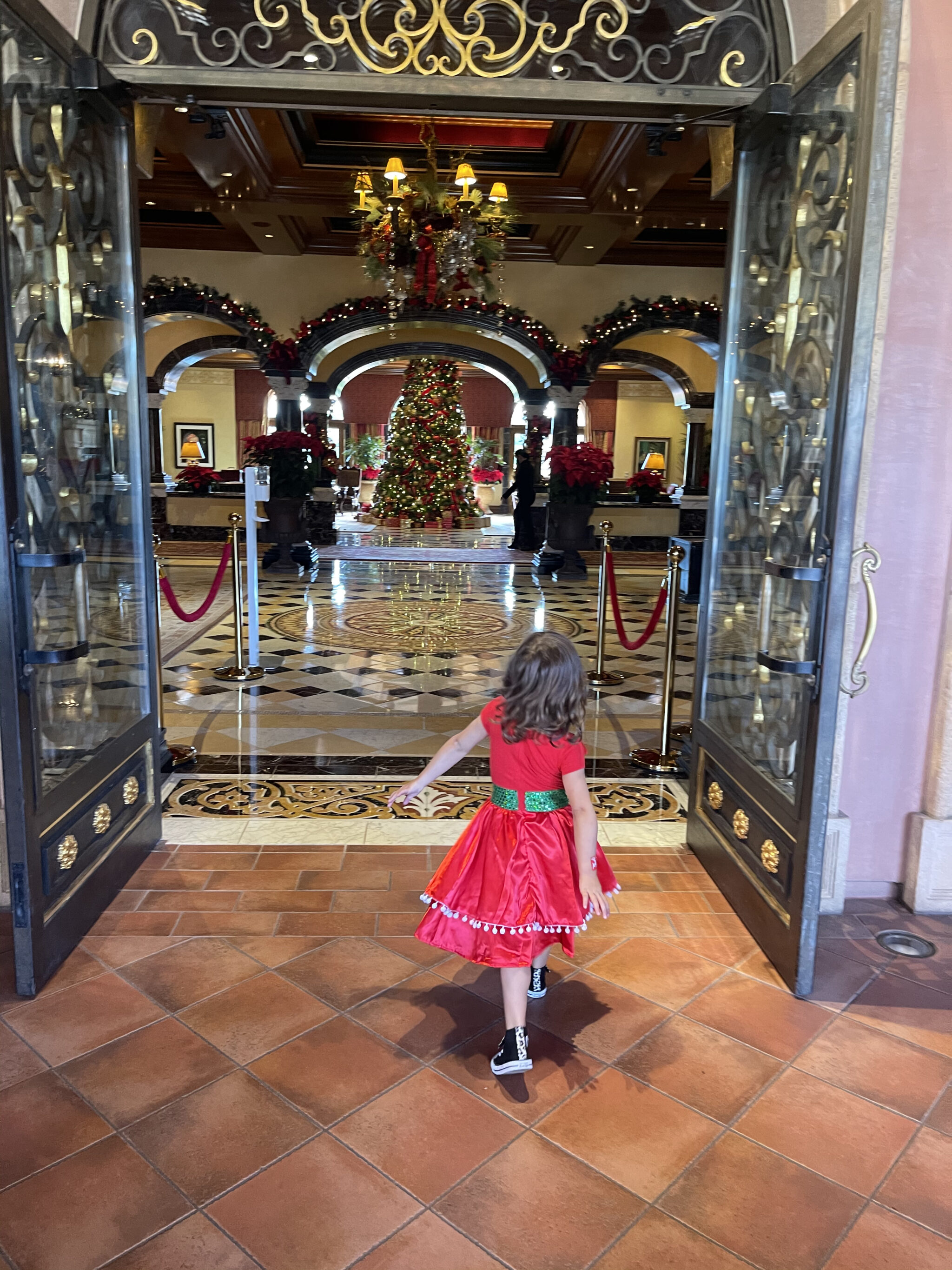 child walking into hotel