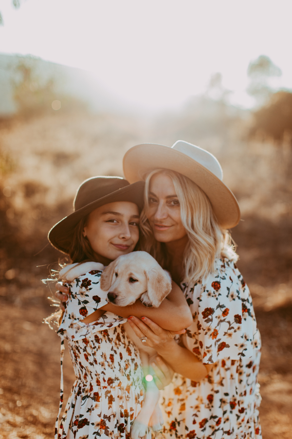 mom and daughter with puppy