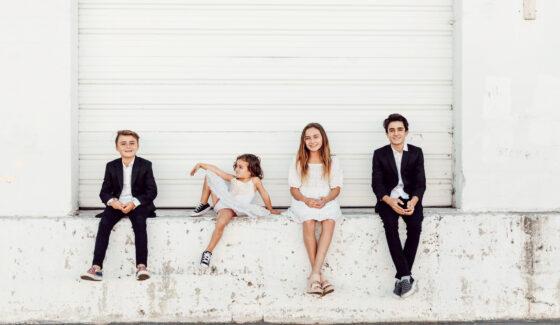 kids sitting outside together