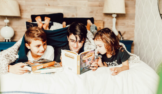 brothers reading books together