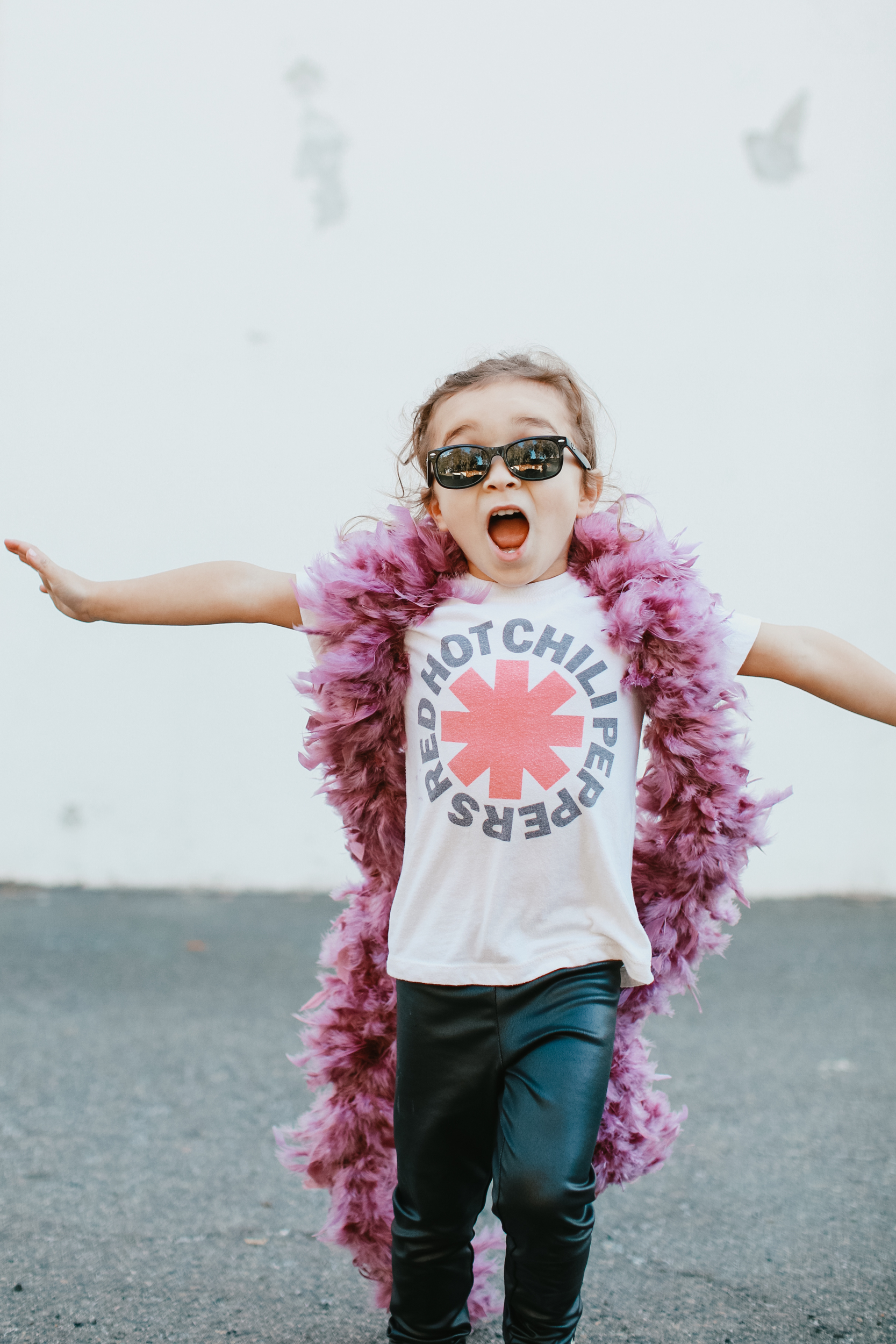toddler in feather boa