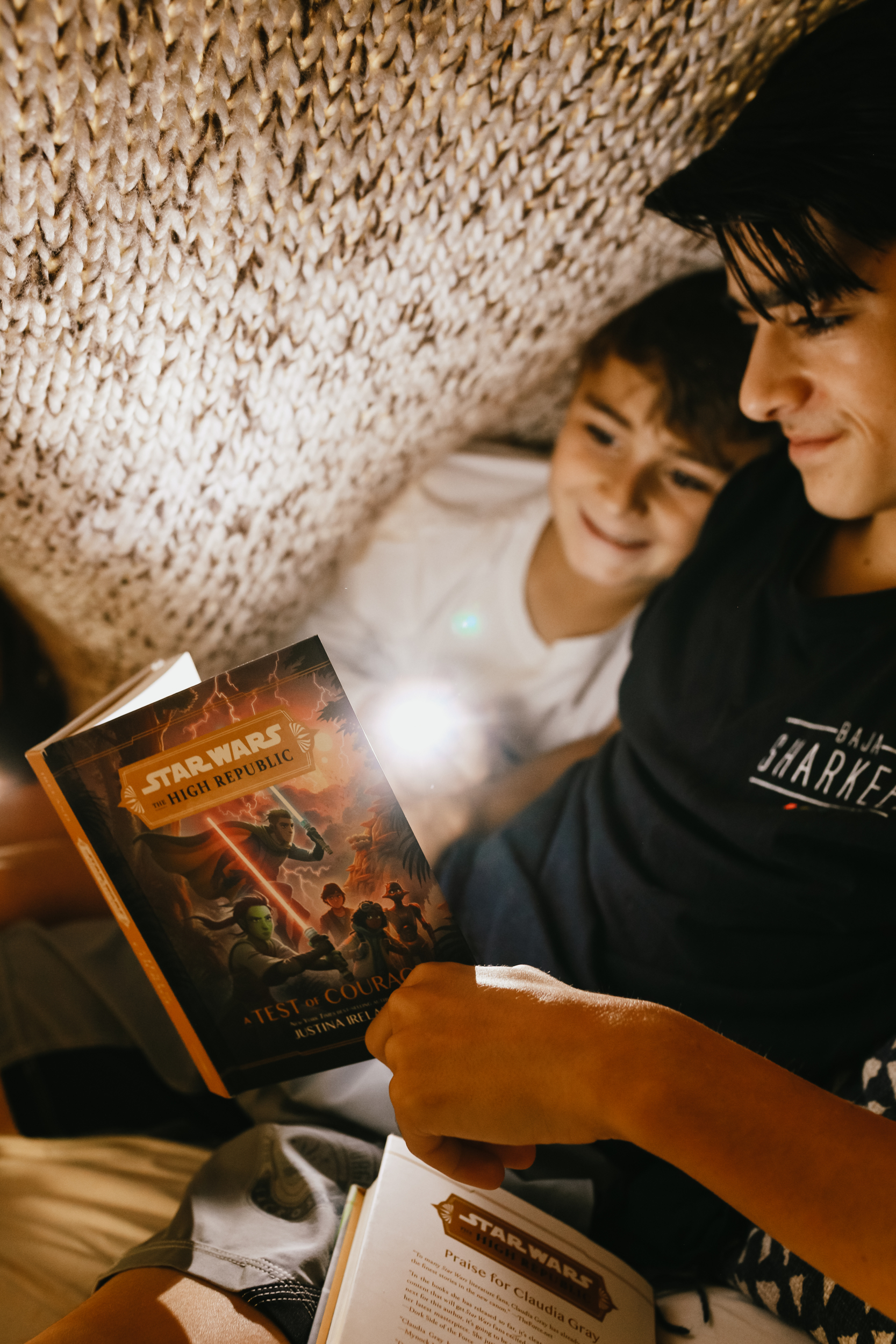 boys reading under the covers