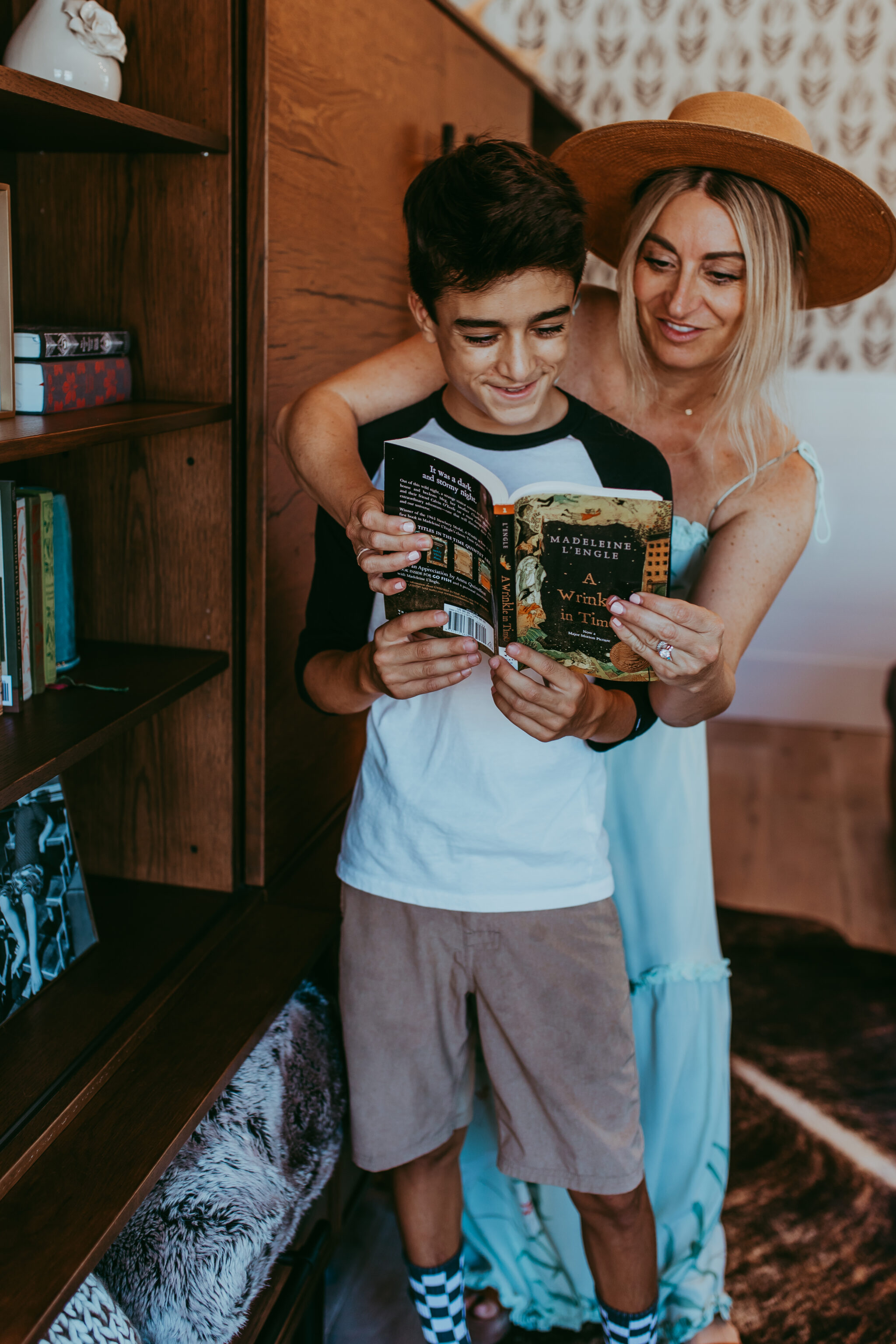 mom helping with son reading