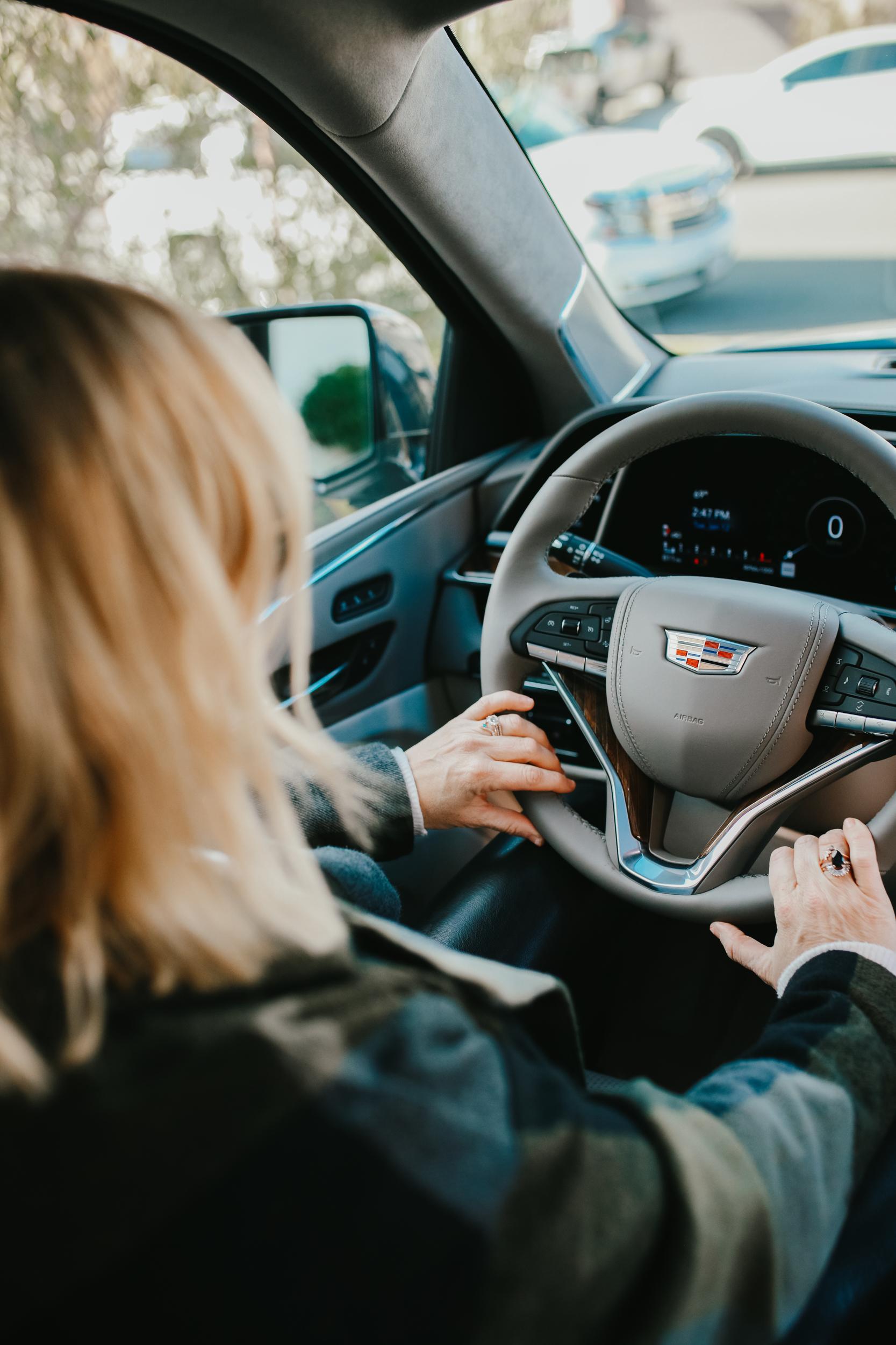 woman driving a cadillac