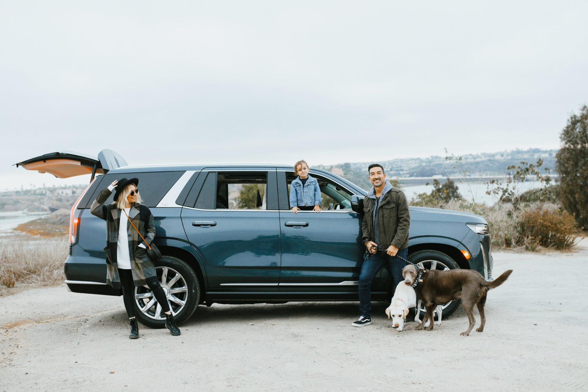 family standing near car